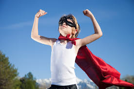 Young boy flexing with a cape. Feeling strong and confident!