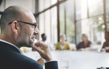 Man at meeting - Engaged and listening fully.